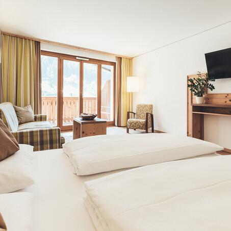Gemütliches Doppelzimmer Bauchgefühl mit Balkon und Holzausstattung im Hotel Nesslerhof, Großarl